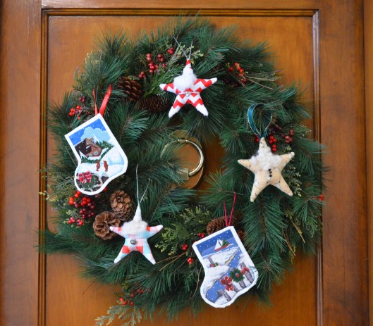 Wreath with santa stars and needlepoint stocking