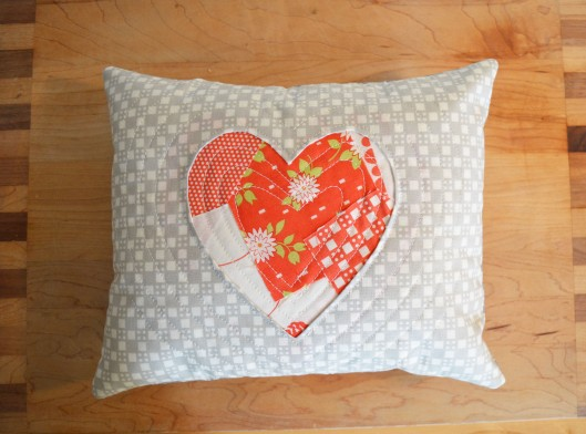 scrappy reverse applique heart pillow red