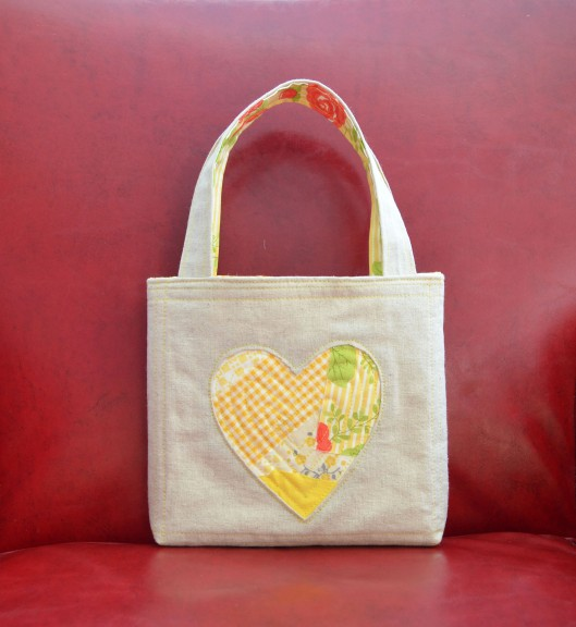 reverse applique heart bag