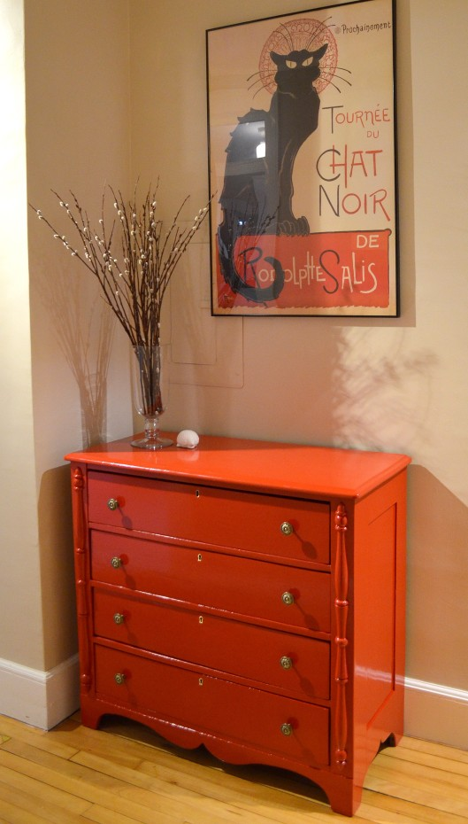 red dresser in hall