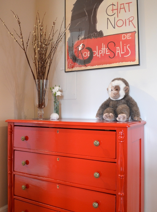 red dresser with monkey